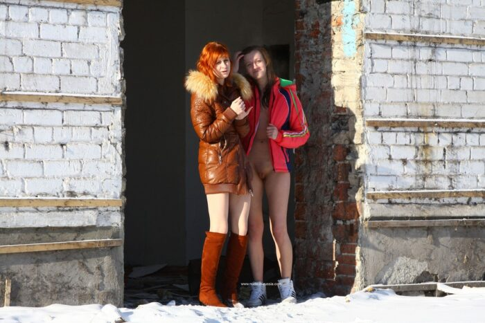 Two hot girls posing at abandoned house