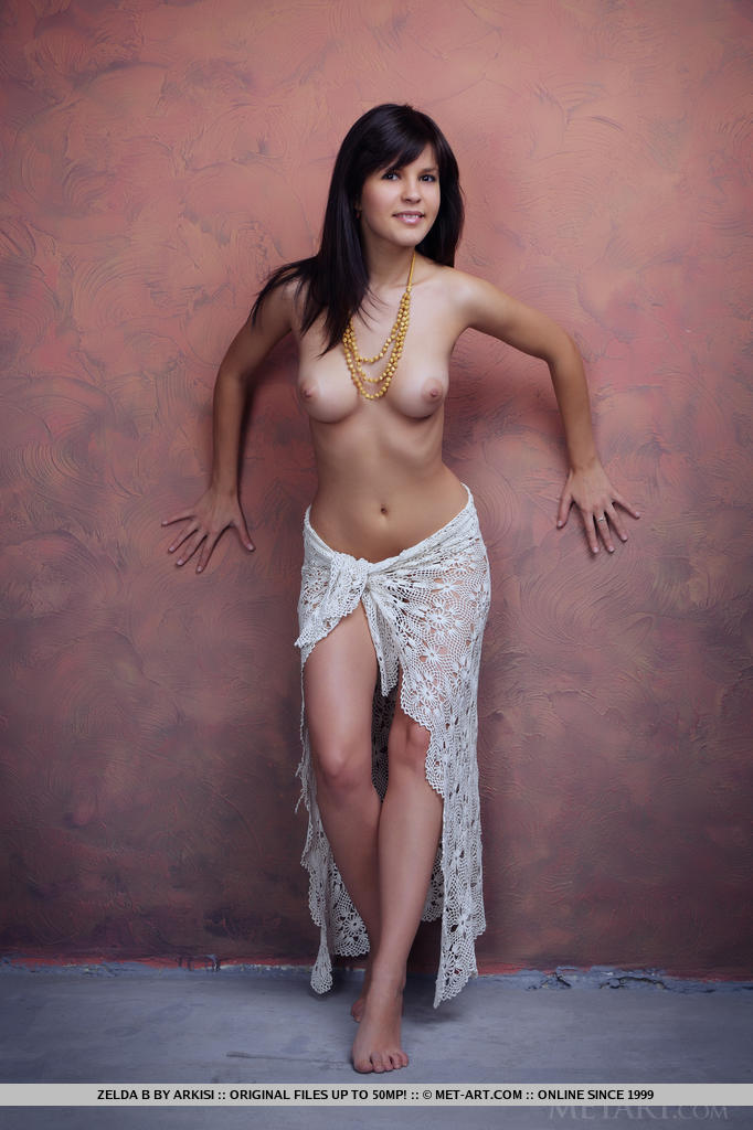 With a white frilly shawl to cover her fine luscious body, Zelda makes an enchanting presence, posing without any hint of inhibition.