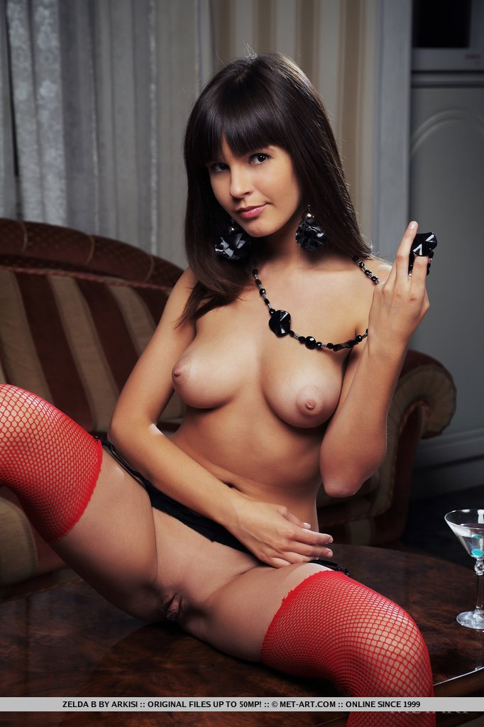 Clad in black lingerie, red thigh-high fishnet and a gorgeous body with enticing assets, Zelda possess all the right stuff for one passionate night.
