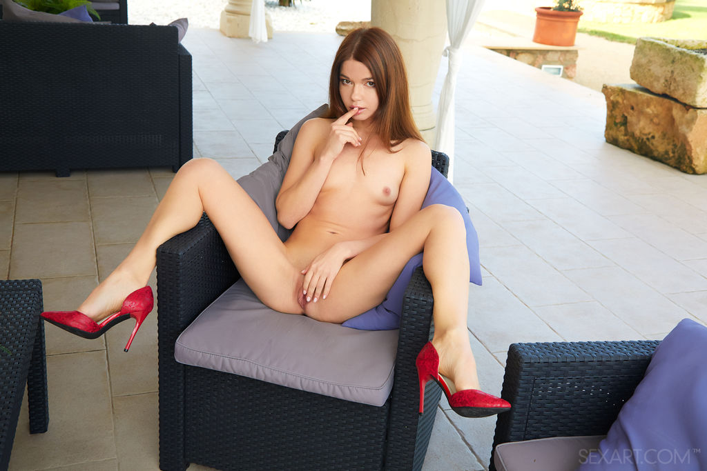 Nedda A masturbates on the chair as she flaunts her sexy legs while wearing her red hot heels.