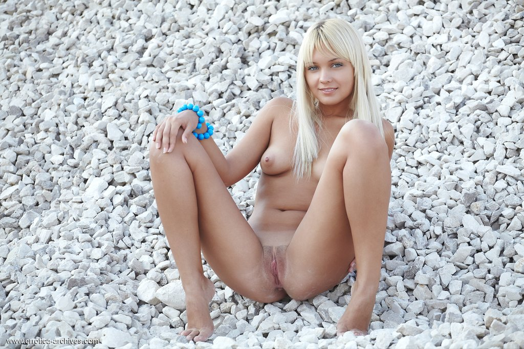 Barefoot and naked, Lada shamelessly displays her nubile body in the open.