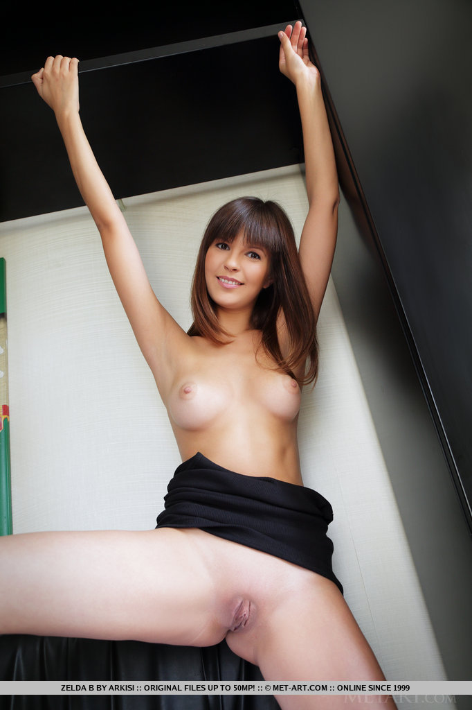 Zelda strips and bares her awesome physique with gorgeous puffy nipples, delectable, pink pussy and sexy legs on top of the bed.