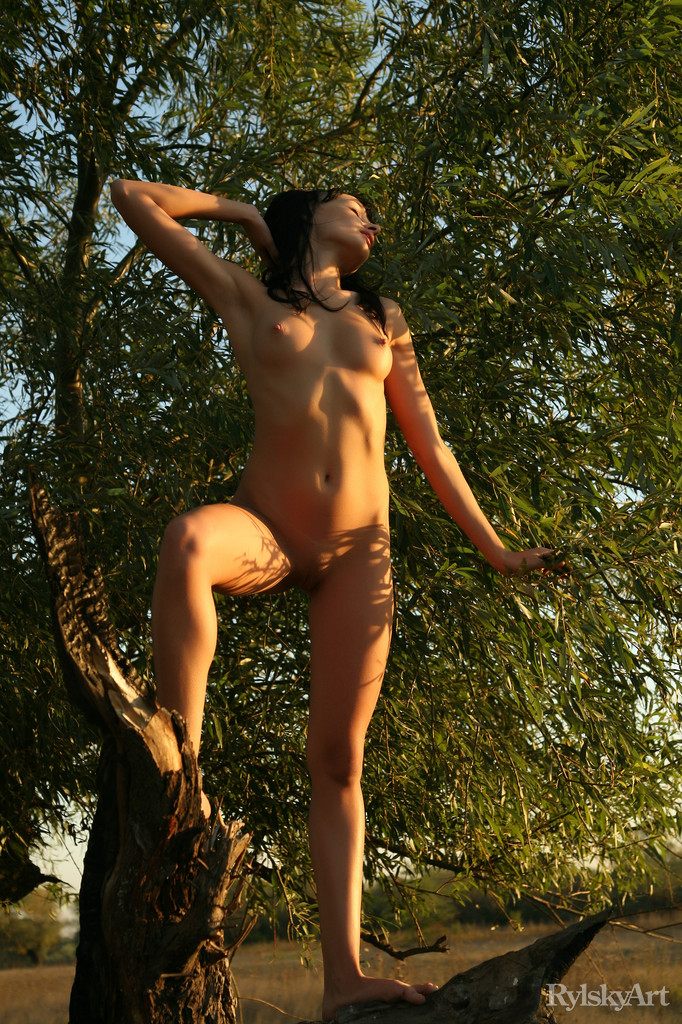 Naked and uninhibited, the fun and carefree Katia poses amongst the lush, verdant outdoors with youthful enthusiasm and childlike curiosity.